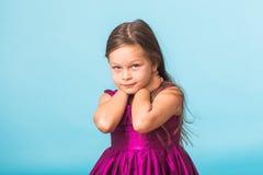 Sweet little girl over blue background stock image