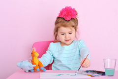Sweet little girl painting at home stock photo