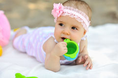 Sweet little girl in a park Royalty Free Stock Images
