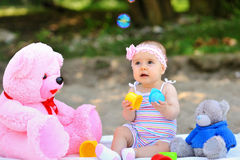 Sweet little girl in a park playing Royalty Free Stock Images