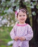 Sweet little girl in the park Stock Photos