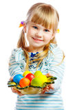 Sweet little girl with plate of Easter eggs. Portrait of smily young girl with Easter eggs Royalty Free Stock Photos