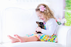 Sweet little girl playing with a rabbit Stock Photo