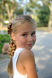 Sweet little girl portrait with looking from back. Outdoor Stock Image
