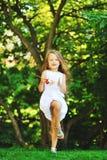 Sweet little girl portrait in a park Stock Image