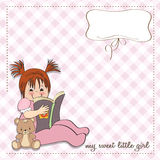 Sweet little girl reading a book Stock Images