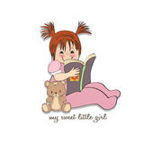 Sweet little girl reading a book Stock Image