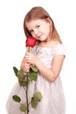 Sweet little girl with red rose. Portrait of happy girl with big red saturated rose over white background Stock Image