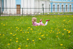 Little girl lying on the lawn Royalty Free Stock Photo