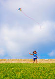 Sweet little girl running with kite Stock Photography
