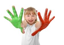 Sweet little girl showing painted hands in color Royalty Free Stock Photography