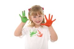 Sweet little girl showing painted hands in color Stock Photos