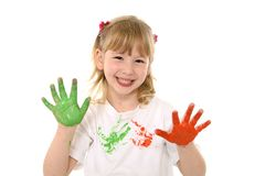 Sweet little girl showing painted hands in color Stock Images