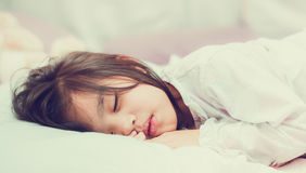 Sweet little girl is sleeping in bed at home Royalty Free Stock Photography