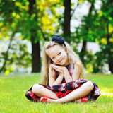 Sweet little girl in a summer park Stock Photography