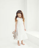 Sweet little girl with teddy bear Stock Photos