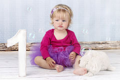 Sweet little girl in tutu skirt catching bubbles Stock Photo