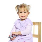 Sweet little girl using mobile phone isolated on white Royalty Free Stock Images