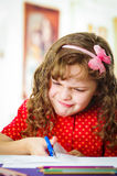 Sweet little girl using scissors Royalty Free Stock Photo