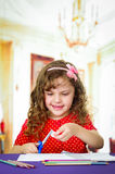 Sweet little girl using scissors Royalty Free Stock Photos