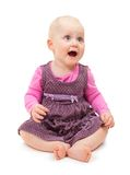 Sweet little girl in violet dress sits Royalty Free Stock Image