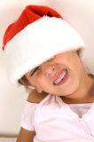 Sweet little girl wearing christmas hat. Portrait of sweet little girl wearing christmas hat Royalty Free Stock Photo