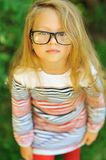 Sweet little girl wearing glasses - outdoor Royalty Free Stock Photography