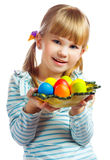 Sweet little girl with yellow Easter egg. Portrait of smily young girl with yellow Easter egg Royalty Free Stock Image