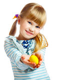Sweet little girl with yellow Easter egg. Portrait of smily young girl with yellow Easter egg Royalty Free Stock Images