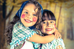 Sweet little girls dressed as a traditional Stock Photos