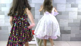 Sweet little girls inside house for playtime and hugging stock video footage