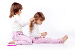 Sweet little hairdresser Royalty Free Stock Image