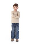 Sweet little kid smiling arms crossed Stock Image