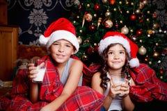 Sweet little kids drinking milk Stock Photo