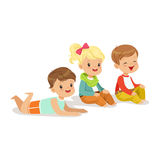 Sweet little kids sitting and lying on the floor, colorful character Stock Photography
