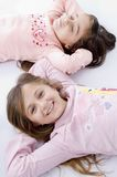 Sweet little laying sisters Royalty Free Stock Photo