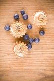 Sweet little muffins and blue berries Royalty Free Stock Photos
