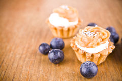 Sweet little muffins and blue berries Stock Photography