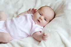 Sweet little newborn baby in a bed royalty free stock images