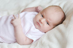 Sweet little newborn baby in a bed Royalty Free Stock Photo