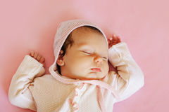Sweet little newborn baby sleeping on the pink blanket Royalty Free Stock Photo