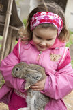 Sweet little rabbit. Portrait of sweet little girl holding a baby rabbit stock photo