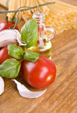 Sweet little red tomatos with olive from olives green basil and garlic Royalty Free Stock Image