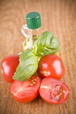 Sweet little red tomatos with olive from olives and green basil Stock Photo