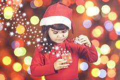 Sweet little Santa girl Stock Photo
