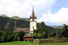 Sweet little Swiss parish church and churchyard Stock Photo