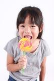 Sweet lollipop. Cute little girl with lollipop Stock Photo