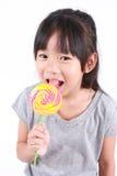 Sweet lollipop. Cute little girl with lollipop Royalty Free Stock Photos