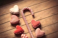 Sweet lollipop and heart shape toys. On wooden background Stock Photography