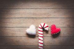 Sweet lollipop and heart shape toys. On wooden background Royalty Free Stock Photos